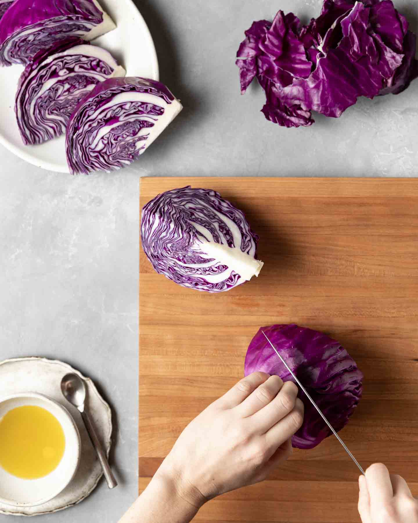 In preparation for cooking, a whole head of cabbage is cut into 8 equal wedges.