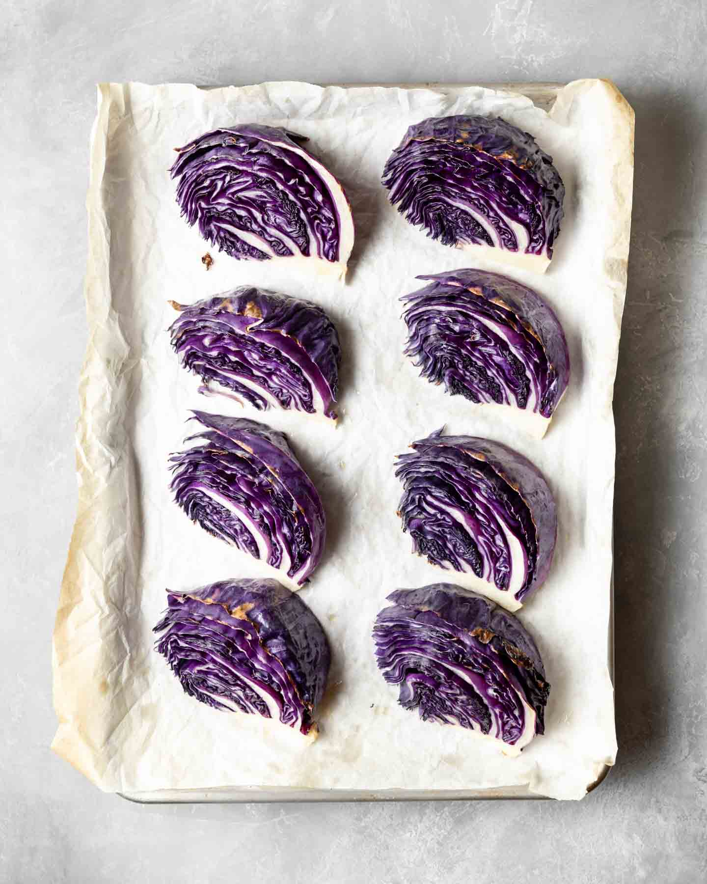 Roasted Red Cabbage on a baking sheet, fresh from the oven.