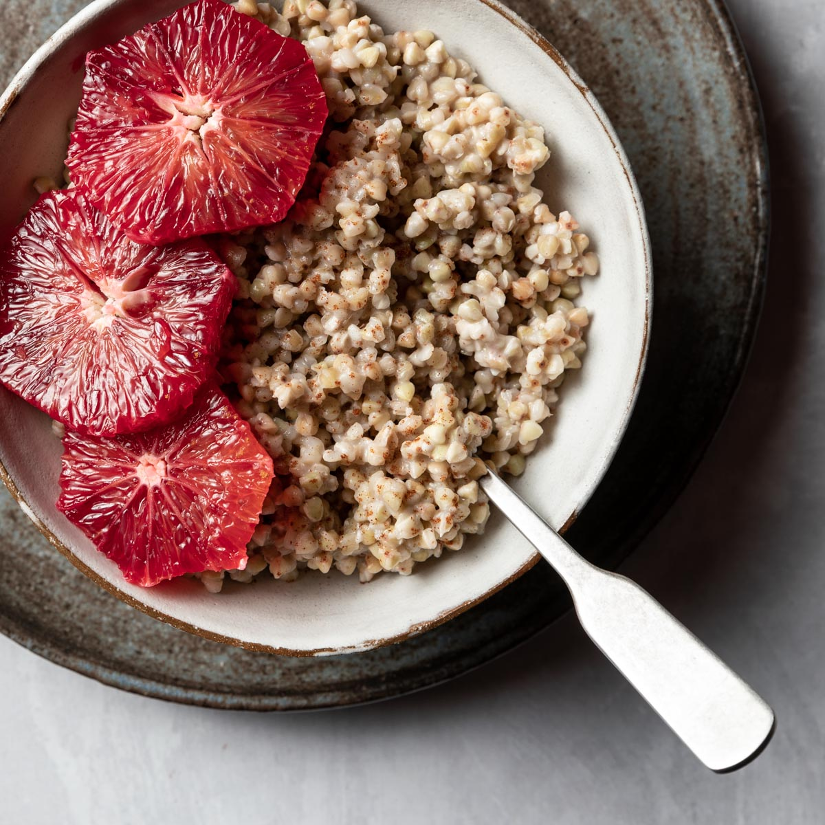 Buckwheat that's been quickly simmered in coconut milk and maple syrup is topped off with slices of blood oranges to make a quick and hearty breakfast.